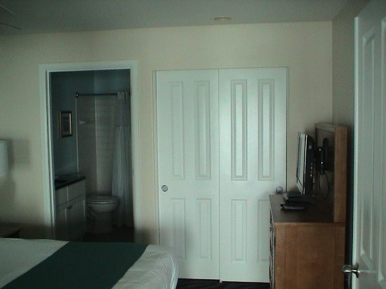 Depoe Bay, OR: The closet, cabinet, and TV in the master bedroom