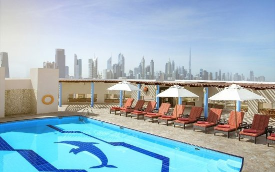Jumeira Rotana: Swimming Pool With Skyline View