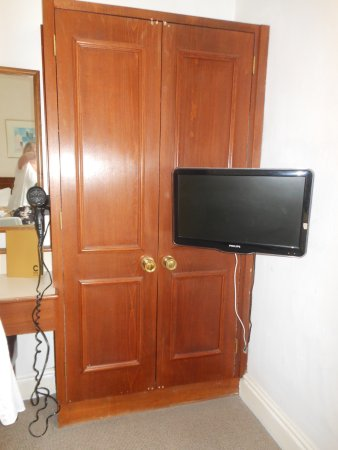 The Washington: screwed doors on wardrobe so TV can be in front so lacked storage