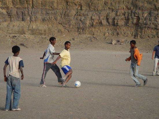 Lalibela Cross Ethiopia Trekking and Tours: Lalibela Cross Ethiopia Eco Trekking and Tours - playing football in Lalibela