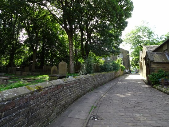 Haworth, UK: View from the church, past the graveyard, to the Bronte Parsonage