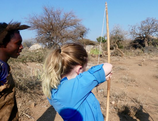 African Scenic Safaris: Our daughter learning to shoot from one of the Hadzabe bushmen