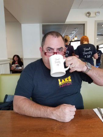 Kings Park, NY: Relish's theme on their coffee mugs: Food, Family, Life! (my husband loves to wear my glasses..