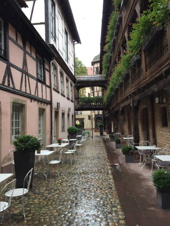 Hotel Cour du Corbeau Strasbourg - MGallery Collection: Hotel Courtyard on a rainy day
