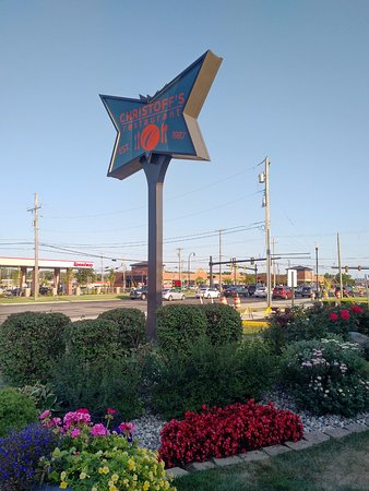Signage and garden in front of PT Christoff's restaurant in Woodhaven, MI