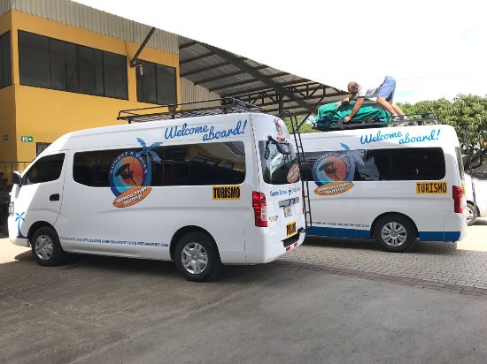 Montezuma, Costa Rica: Tropical Tours Shuttles Minibuses at bus stop in Guanacaste