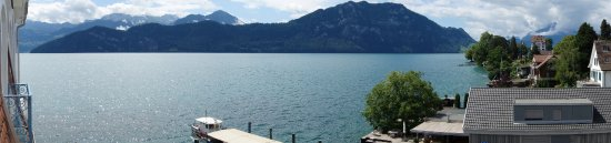 Weggis, Schweiz: View from balcony of lake Lucerne and Mt Pilatus in clouds on the far right