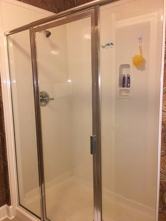 Phoenix West Master Shower With Two Heads Not As Clean It Should Double Doors From Bedroom Into Dining Area