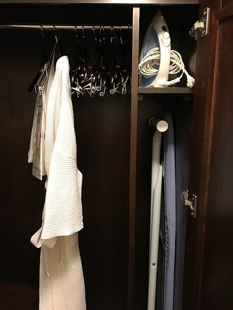 The Carolina Inn: Small closet with robe, iron, and ironing board
