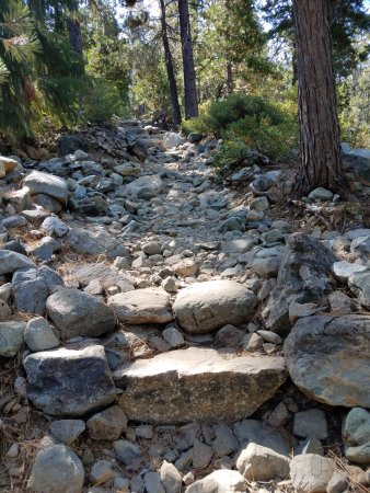 Graeagle, CA: Typical stretch of Grass Lake trailhead - continuous uphill with boulders and small rocks