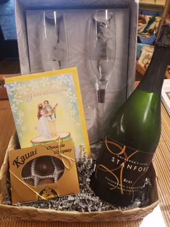 What a gift basket pineapple cutter pineapple rum and yes savage at hanalei bay resort congratulate some newlyweds with a wedding gift basket sciox Choice Image