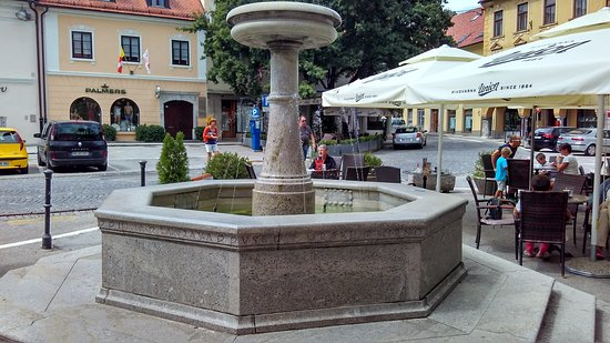 Novo Mesto, Eslovenia: Fountain honoring poet Dragotin Kette whose song is engraved on fountain