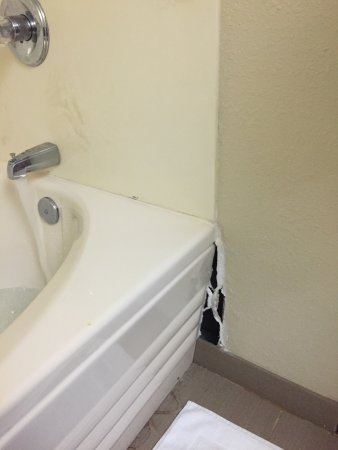 Huron, OH: hole in wall where tub unit pulled away from wall