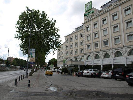 Holiday Inn Istanbul City: Exterior of hotel, from street. Metro/tram station across street, on left.