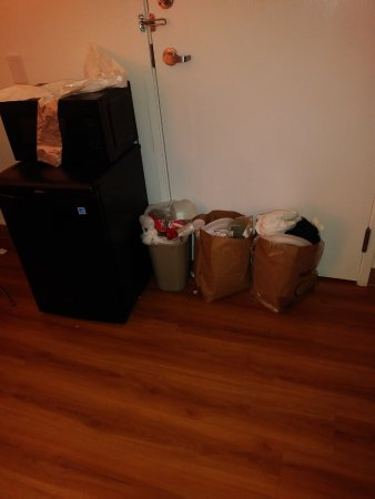 Motel 6 Orlando International Drive: overflowing garbage in the room after 2 days ,we was given garbage bags sitting on the microwave