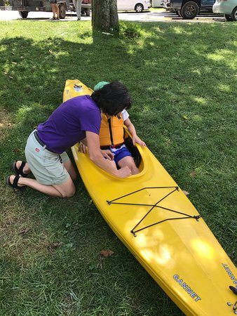 Cambridge, NY: Child getting fitted in her kayak.