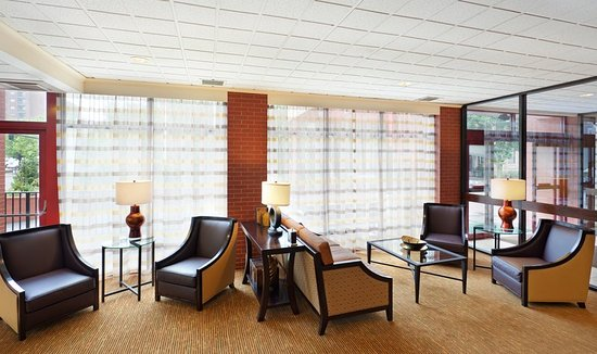 Brookline, MA: Guests can enjoy a morning cup of coffee in our bright  lobby.