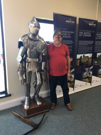 Carrickfergus, UK: My husband having a bit of a laugh trying on the armour