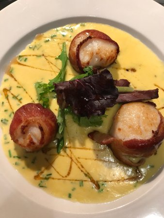Bristol, RI: Bacon wrapped sea scallops in sweet summer corn and local honey.