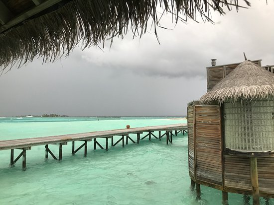 Gili Lankanfushi Maldives: Even when stormy its beautiful. View to jetty and next villa