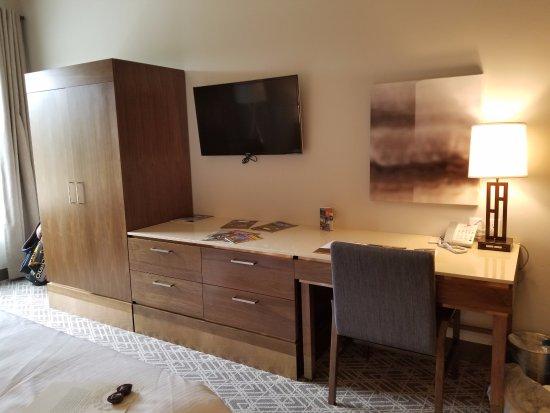 Portola, CA: closet armoire, tv, and desk area