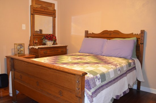 Richmond, IL: Lake Mary room features beautiful Eastlake double bed set.