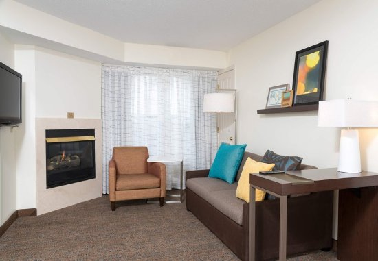 Grandville, MI: Two-Bedroom Suite - Living Area with Fireplace
