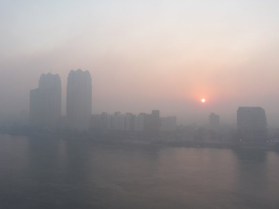 Hilton Cairo Zamalek Residences: Hazy morning view of Nile from our balcony