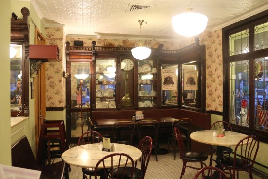 Old World Cafe and Ice Cream : Ornate wod carvings and fixtures have history.