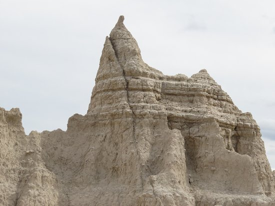 Interior, SD: Rock pinnicle and layers in Badlands NP.