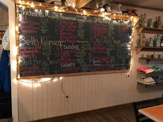 The Duck Pond Eatery & Beer Garden: The wall of beers