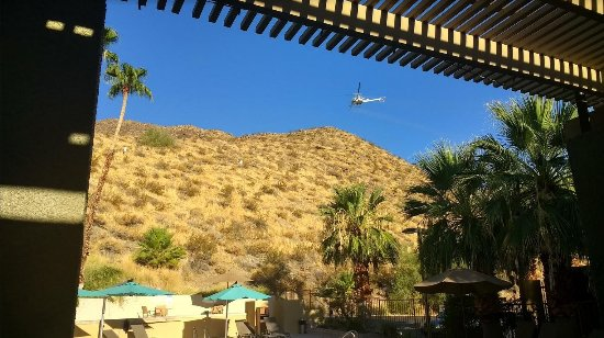 Best Western Inn at Palm Springs: Helicopter insecticide spraying over the dining area during Breakfast