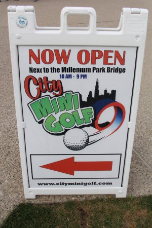 City Mini Golf: Sign with hours and website.