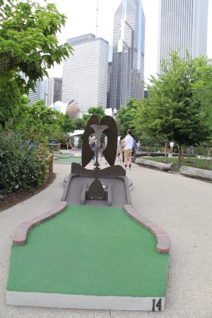 City Mini Golf: A Plinko Style Hole with sculpture.