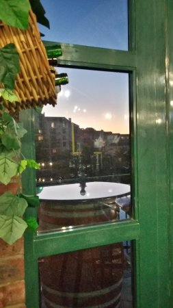 Dros Restaurant and Wine Cellar: ...a sunset seen through the window