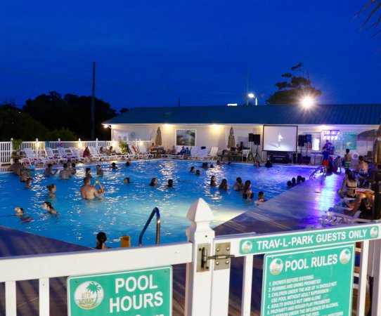 Holiday Trav-L-Park Resort: Nighttime pool party with a DJ and karaoke. What more could you want?