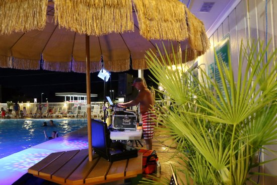 Holiday Trav-L-Park Resort: DJ Schmidty at one of our summer-time pool parties.