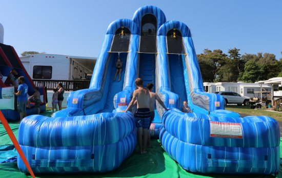 Holiday Trav-L-Park Resort: Our giant 30' inflatable water slide is a great way to cool off during hot summer days.