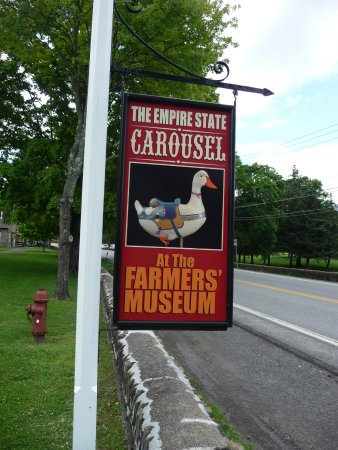 Cooperstown, NY: sign on street promoting the carousel