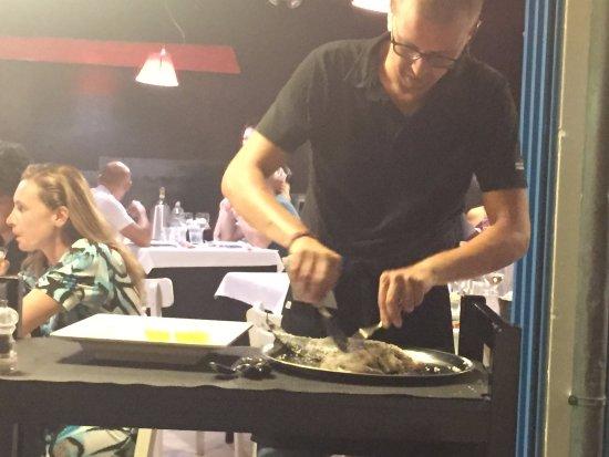 Ristorantino Prima Secca: fish in saltcrust being prepared