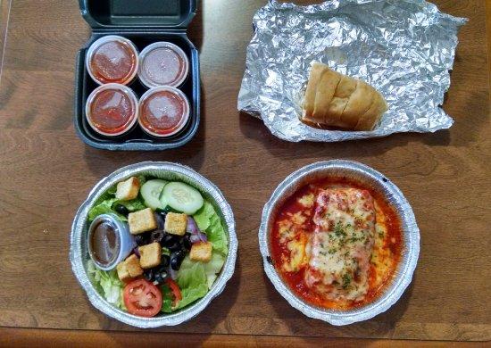 Gilbert, AZ: Lasagna, freshly baked bread, salad, marinara sauce.