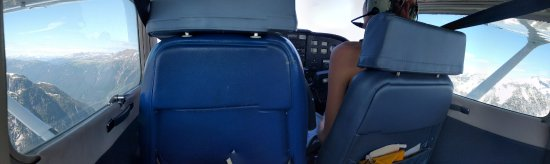 Glacier Air: My daughter in the co-pilot seat high above Mts & glaciers