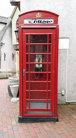 love the old telephone booth! - Picture of The Village Shops