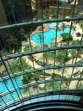 JA Oasis Beach Tower: the pools: photo taken from INSIDE lift whilst passing through 30th floor
