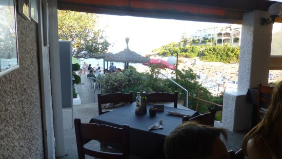 Restaurante Cala Mandia : View overlooking the outside area that was full at 7pm.