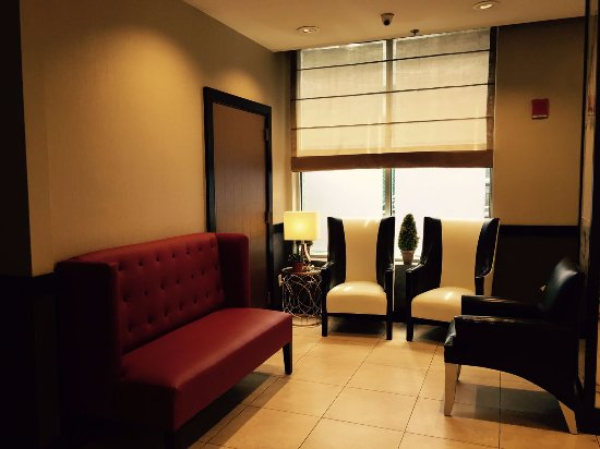 lobby seating area picture of pointe plaza hotel. Black Bedroom Furniture Sets. Home Design Ideas
