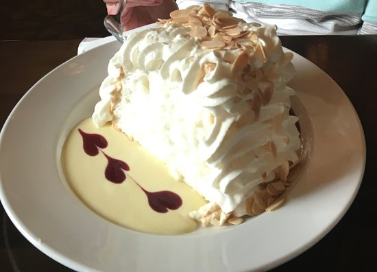 The Parlour : House Specialty Pavlova-fresh lemon crème anglais, raspberry coulis, whipped cream, toasted almo