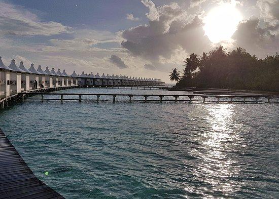 Cinnamon Hakuraa Huraa Maldives: View of the Water villas at sunset
