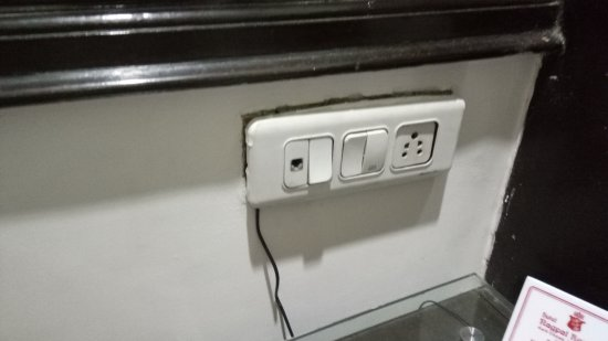 Hotel Nagpal Regency: Switch box holder look so fragile that it will break at any moment