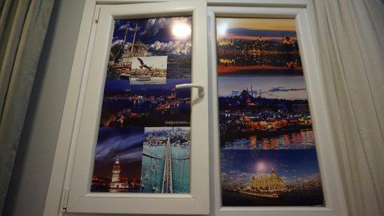 Raymond Blue Hotel: window with no view, room 108